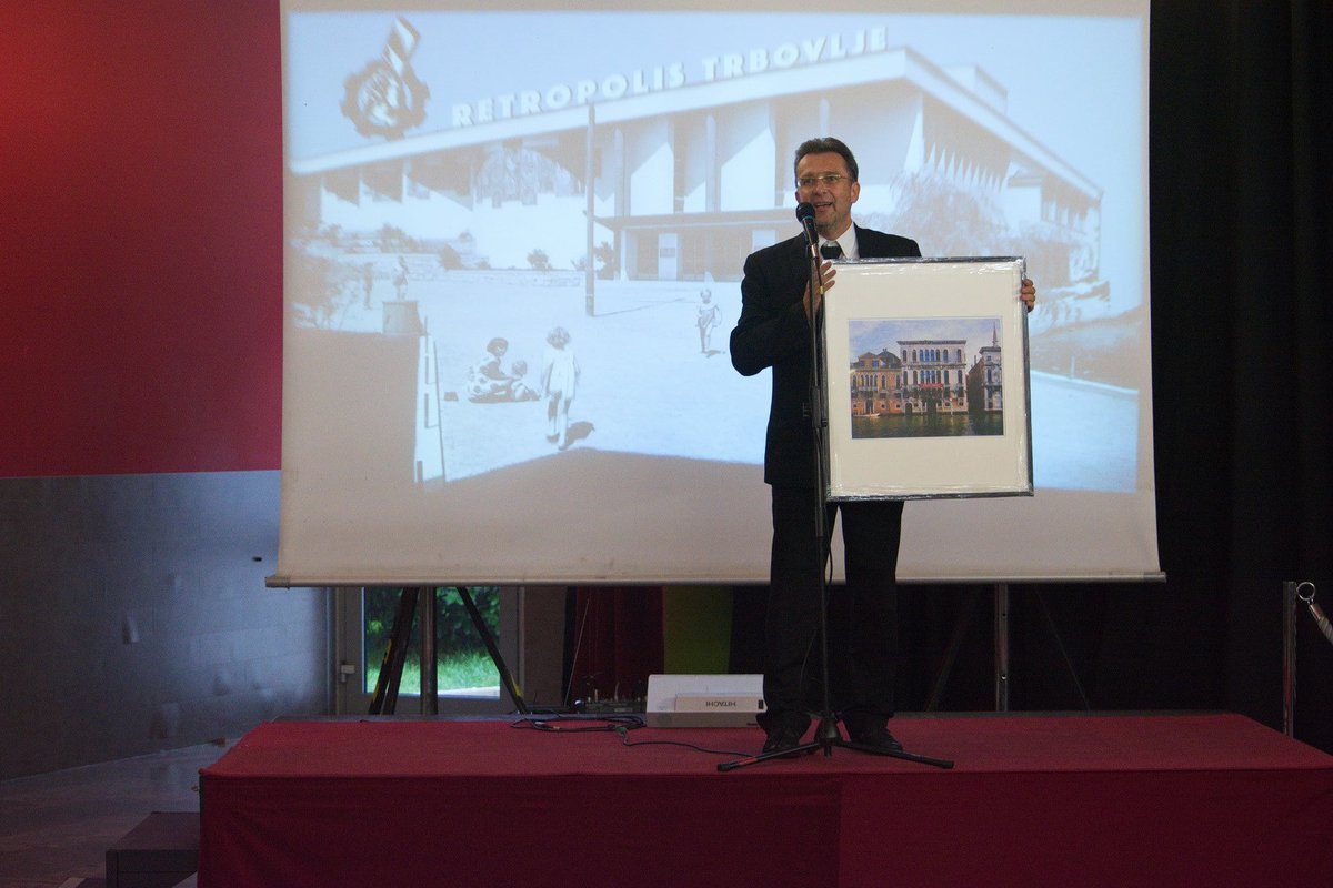 Roman Uranjek, IRWIN member from Trbovlje, presenting the special Irwin award to the audience. Its recipient was NSK State FAB3 artist Haris Hararis, for the series of posters produced for the music group Laibach, who also originate from Trbovlje; thus binding the two NSK (State) domains of music and visual arts.
