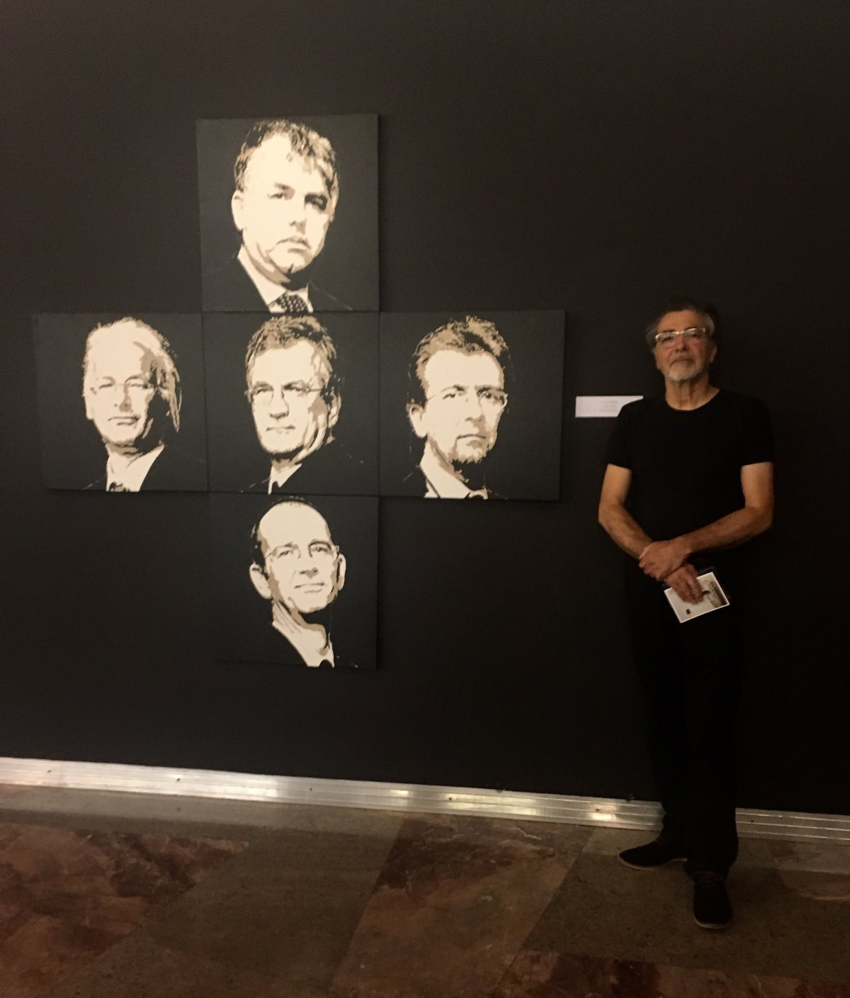 Matjaž Stopar (Slovenia) in front of his painting of the IRWIN group members' portrait.